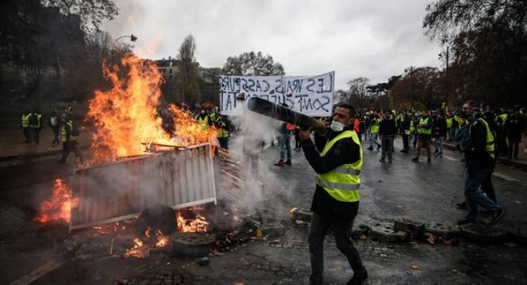 France to suspend fuel tax hike after protests