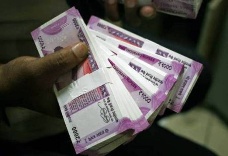 Rupee slips 17 paise to 69.59 against US Dollar